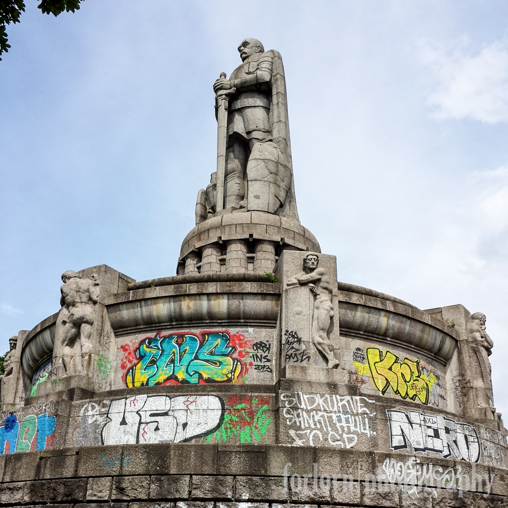 This is the Bismarck Monument, located in the St. Pauli quarter of Hamburg.  It was built in 1906 and has a series of catacombs underneath it that was used as a bomb shelter during the war.  Unfortunately, you can't get in there anymore.  As you can see, graffiti vandals aren't showing much respect for old Otto these days.  Camera: Samsung Galaxy S4
