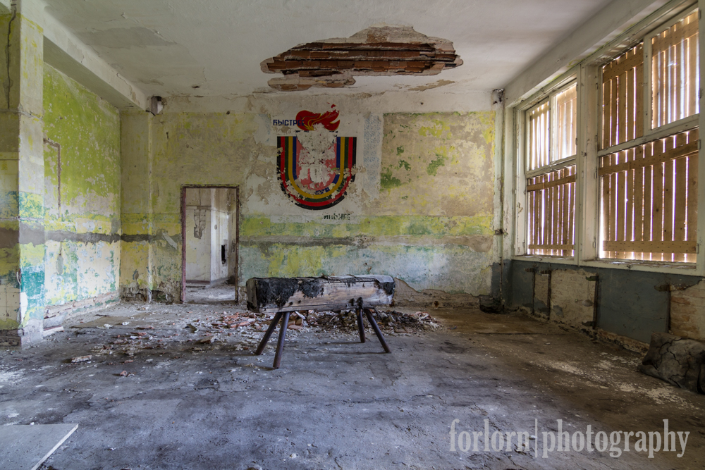 This room next to the dilapidated equipment had an old Soviet painting on the wall.  (Camera: Canon Rebel T3i)