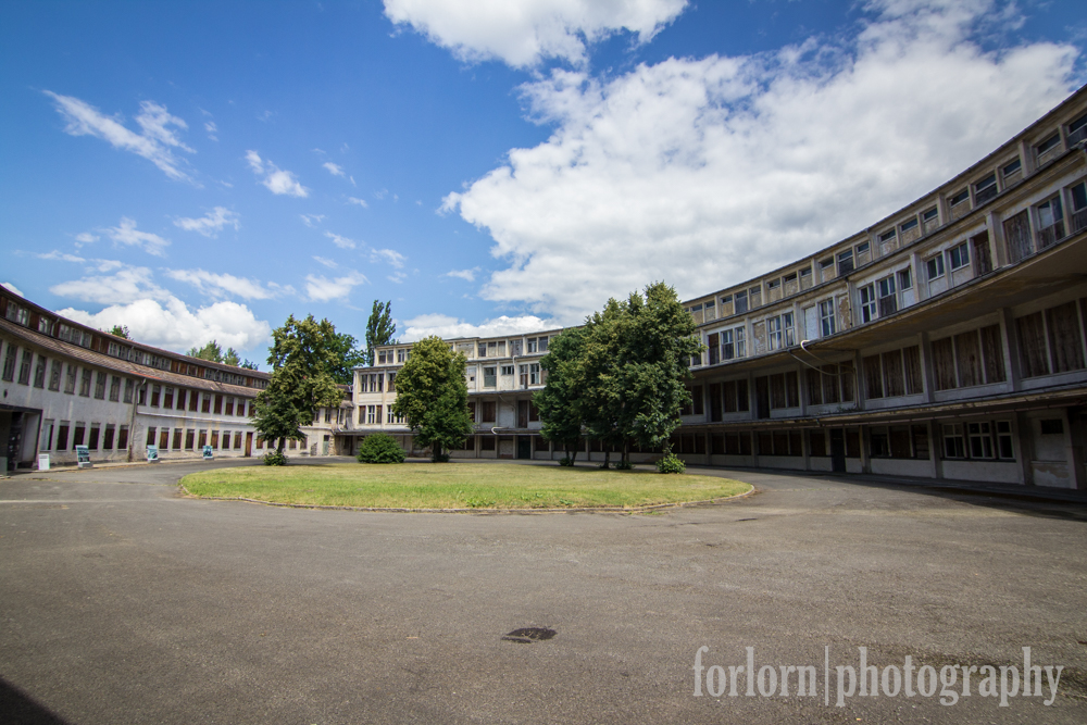"""The grandest structure at the village is the """"Hall of Nations"""" or something like that  - an immense oval structure that housed all the kitchens and dining halls for the athletes, along with a theater and some other amenities.  (Camera: Canon Rebel T3i)"""
